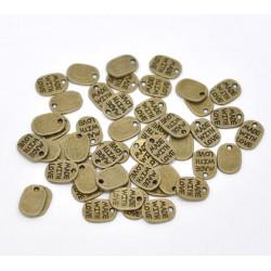 "10 ou 20 Pendentifs Bronze "" made with love "" 11mm x 8mm MC1100006"