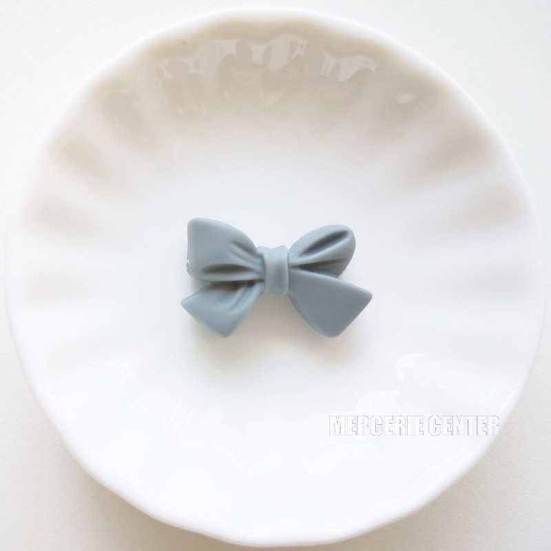 Perle en Silicone Noeud Papillon 27mm x 17mm