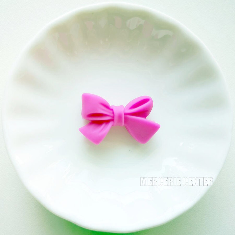 Perle en Silicone Noeud Papillon 27mm x 17mm